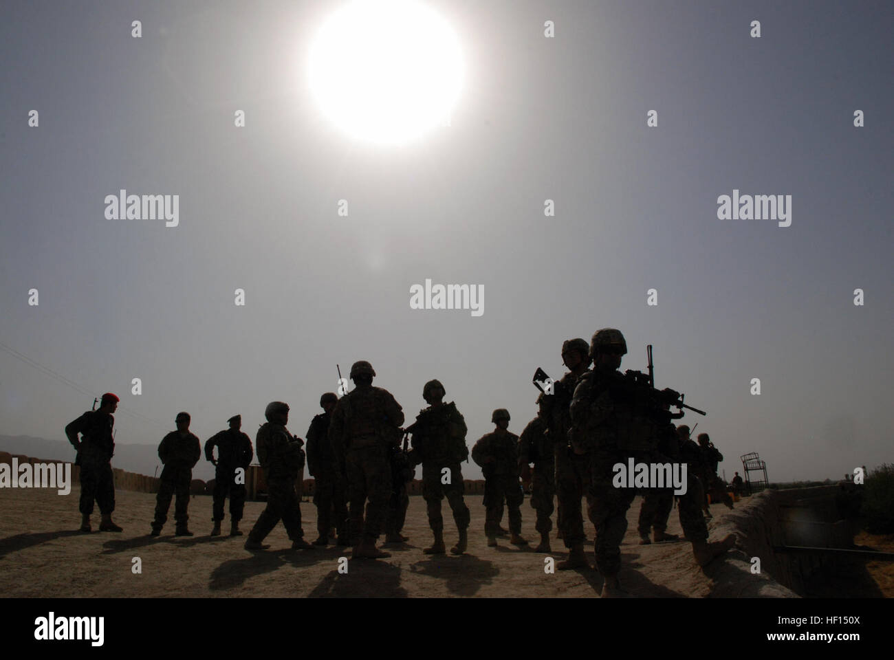 The sun bears down of Guam Army National Guardsmen and Afghan National Army soldiers Sept. 30 at Qala-I-Jangi, Balkh - Stock Image