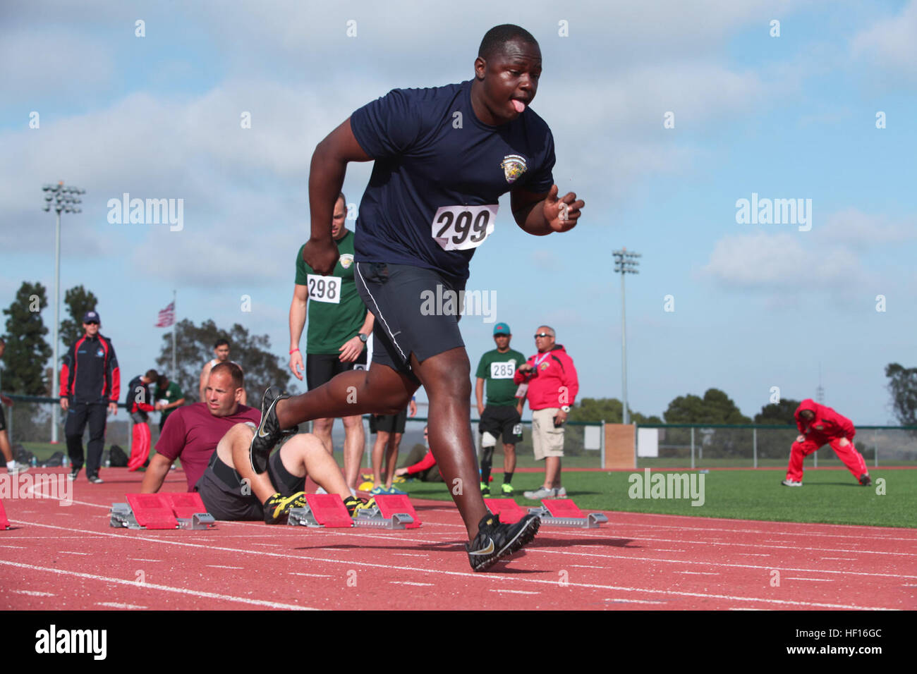 Lance Cpl. Zachary Hopkins, with Wounded Warrior Battalion West, practices starting from the blocks moments before - Stock Image