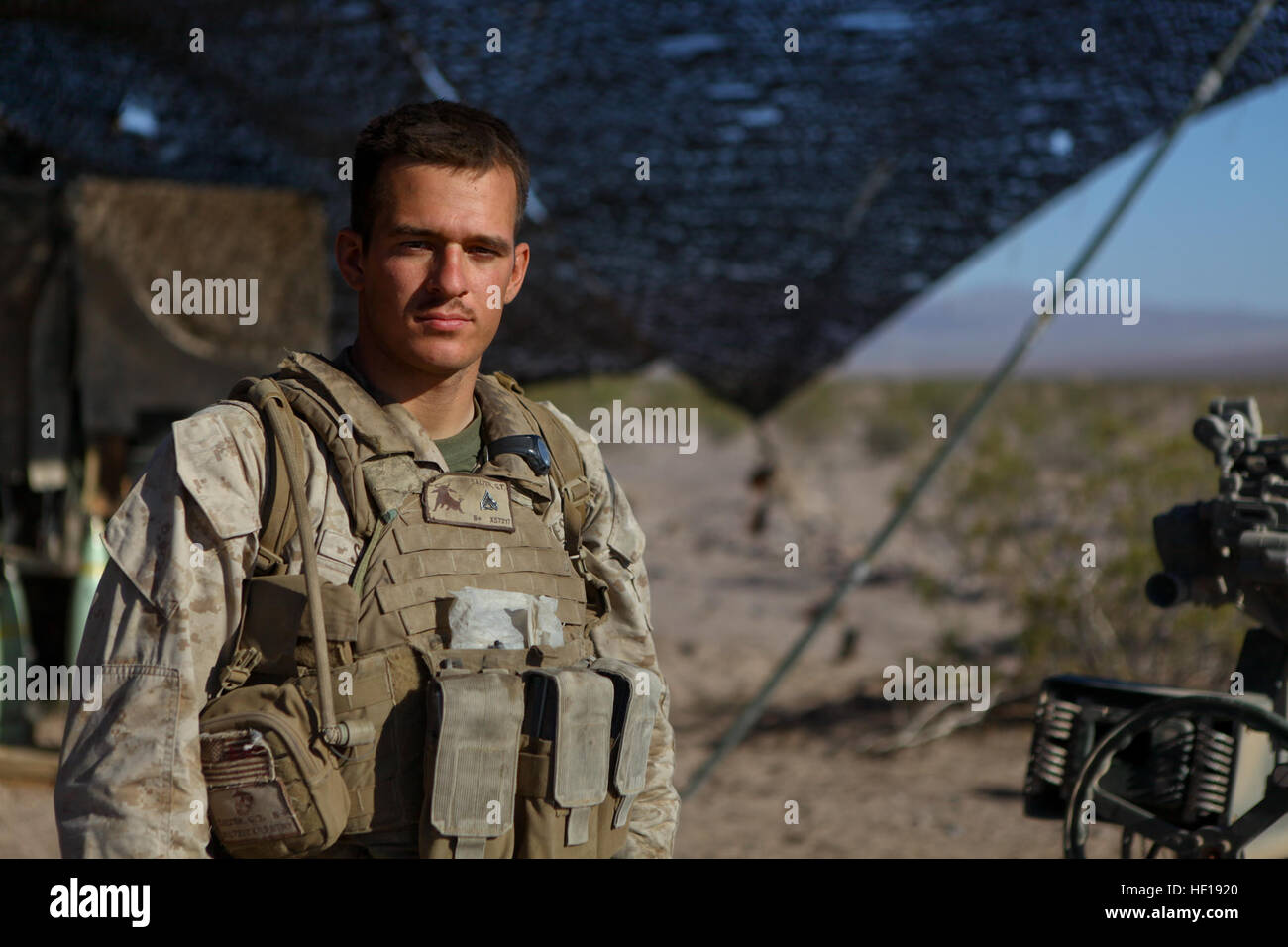 Corporal Gregory Salyer, a gunner serving with Kilo Battery, 3rd Battalion, 12th Marine Regiment, attached to 2nd - Stock Image
