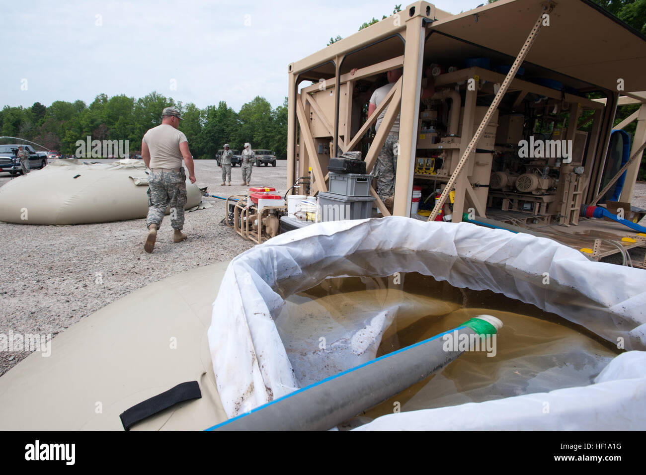U.S. Army National Guard soldiers assigned to the 741st Quartermaster, South Carolina National Guard, purify lake Stock Photo