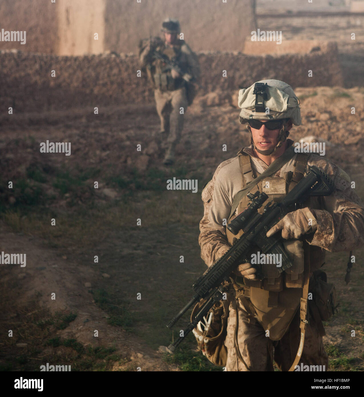 U.S. Marines with Fox Company, 2nd Battalion, 2nd Marine Regiment patrol during a cordon and search mission in Habib Stock Photo