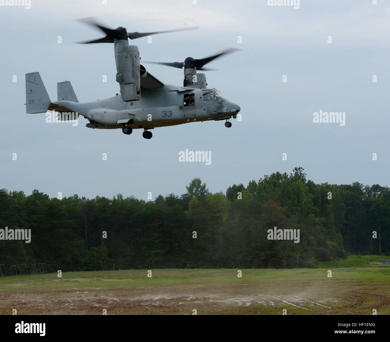 An MV-22 Osprey from Marine Medium Tiltrotor Training Squadron 204 lands at LZ 7 on Aug. 23, 2013. VMMT-204 was Stock Photo