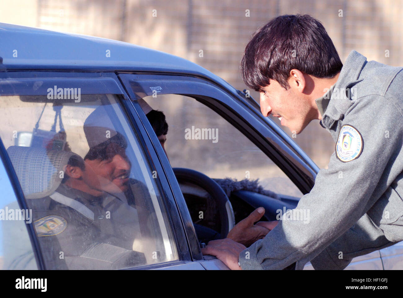 An Afghan border police checks a car at a border crossing road in eastern Khowst. The ABP recently re-structured - Stock Image