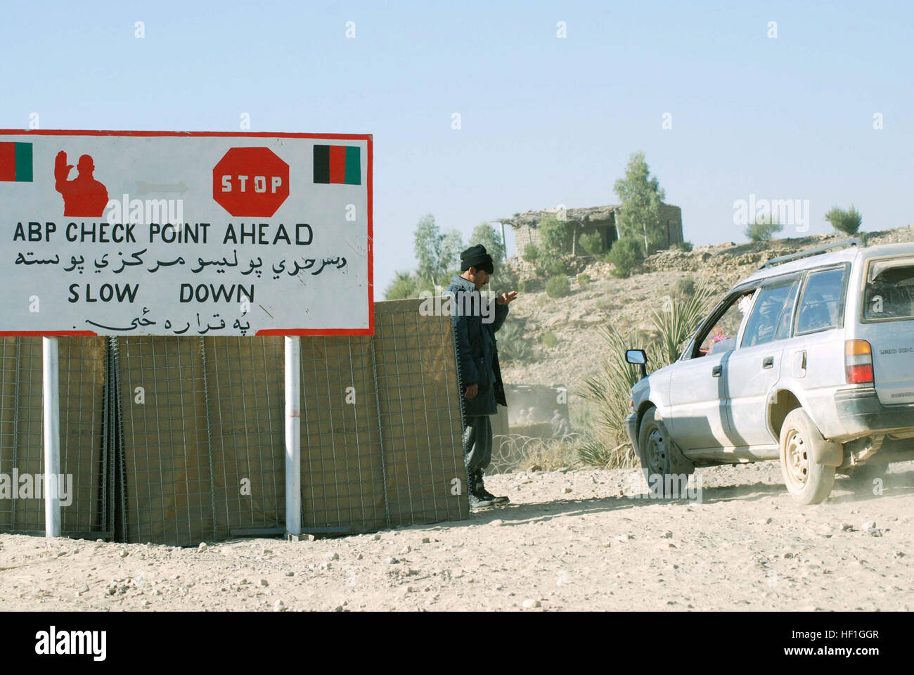 An Afghan border police stops a car at a border crossing road in eastern Khowst. The ABP recently re-structured - Stock Image