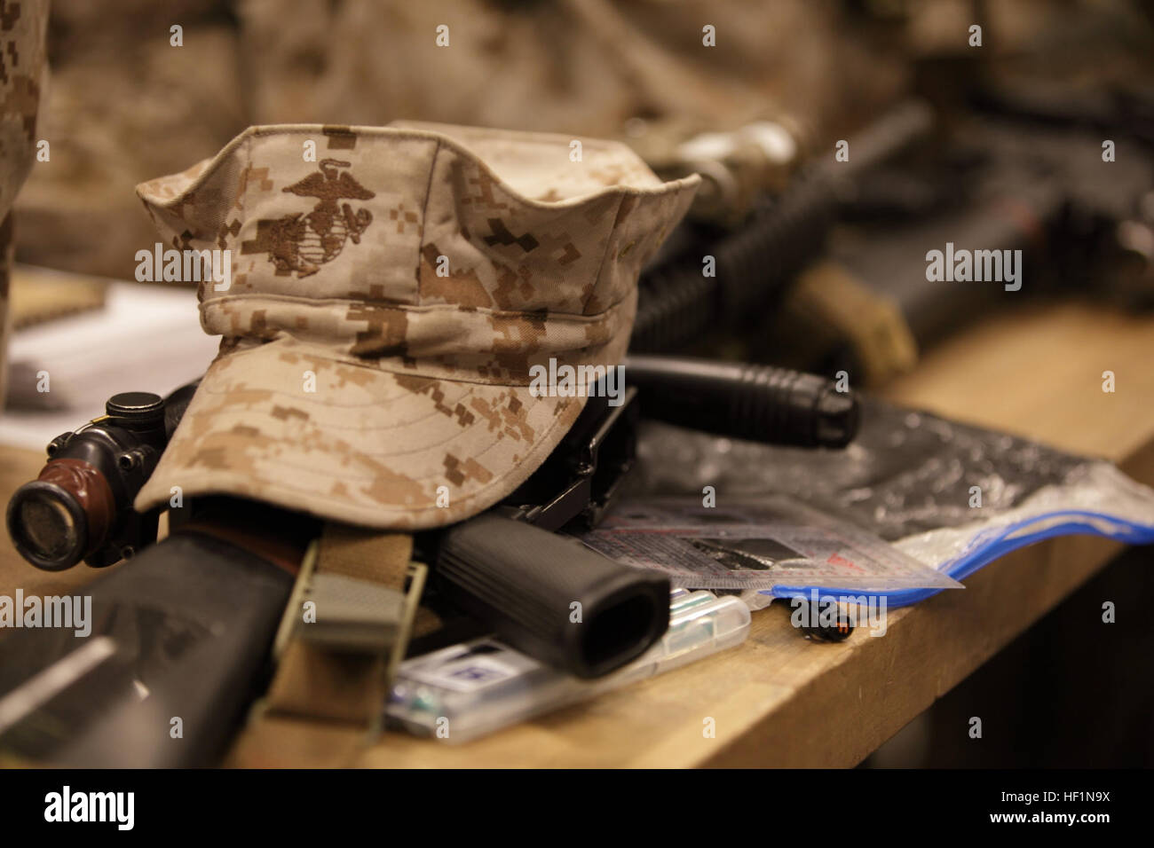 A U.S. Marine Corps desert utility eight point cover is shown atop of an M16 A4 service rifle during the Basic Infantryman's Stock Photo