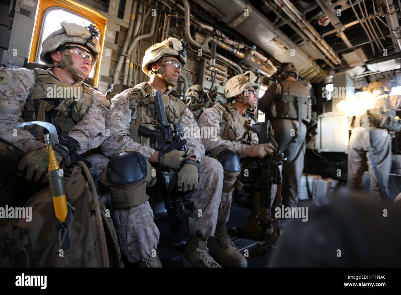 U.S. Marines with Bravo Company, 1st Battalion, 9th Marines Regiment are transported by a CH-53 Super Stallion over Stock Photo