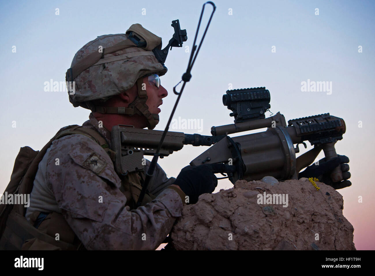 Lance Cpl. Nathan Gulbronson, a Lambertville, Mich., native and rifleman with 1st Battalion, 9th Marines, watches Stock Photo