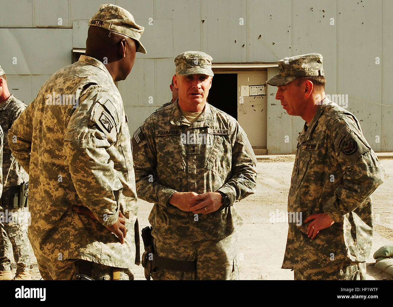 Minutes after a memorial service at Forward Operating Base Falcon, Maj. Gen. Jeff Hammond (center), the commanding - Stock Image