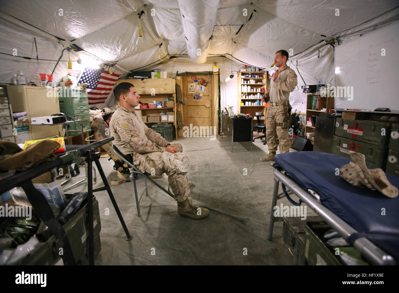 Petty Officer 3rd Class Kristopher Krysa, right, 27, from La Grange Park, Ill., a corpsman with Security Force Assistance - Stock Image