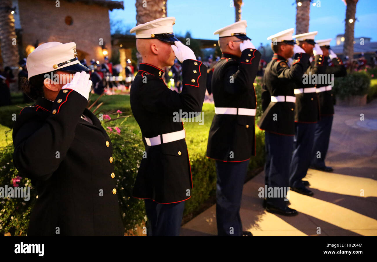 Marine Corps Junior Reserve Officers' Training Corps cadets from Desert Hot Springs High School salute during - Stock Image