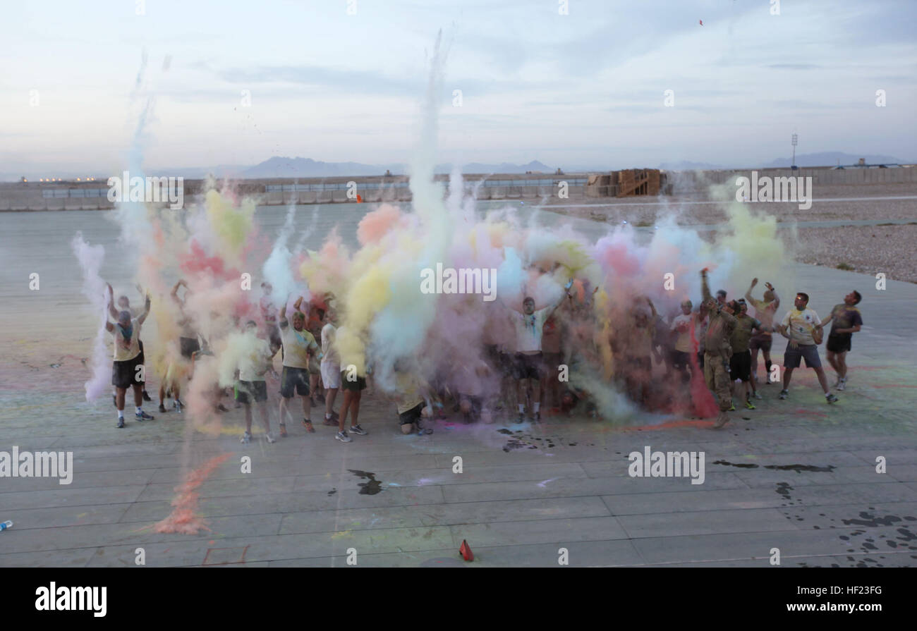 Participants throw colored cornstarch into the air to celebrate completing the Dustoff 'Splash Dash' 5K - Stock Image