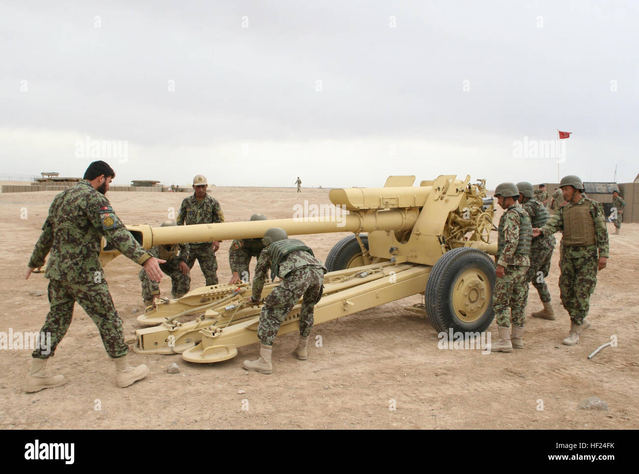Afghan National Army soldiers with the 215th Corps begin to set up the D-30 122 mm howitzer during training aboard - Stock Image