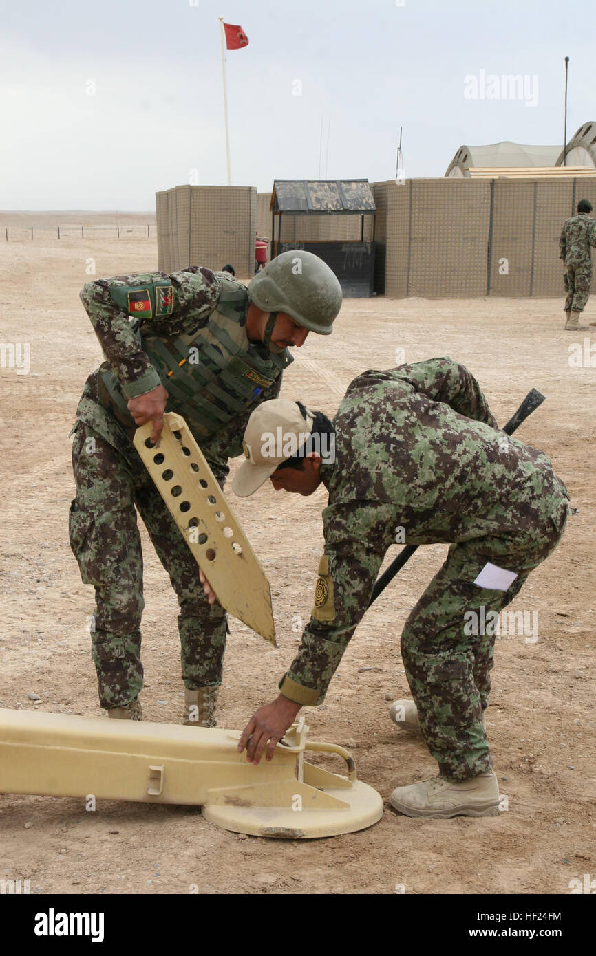 Afghan National Army soldiers with the 215th Corps use large metal stakes to secure the D-30 122 mm howitzer during - Stock Image