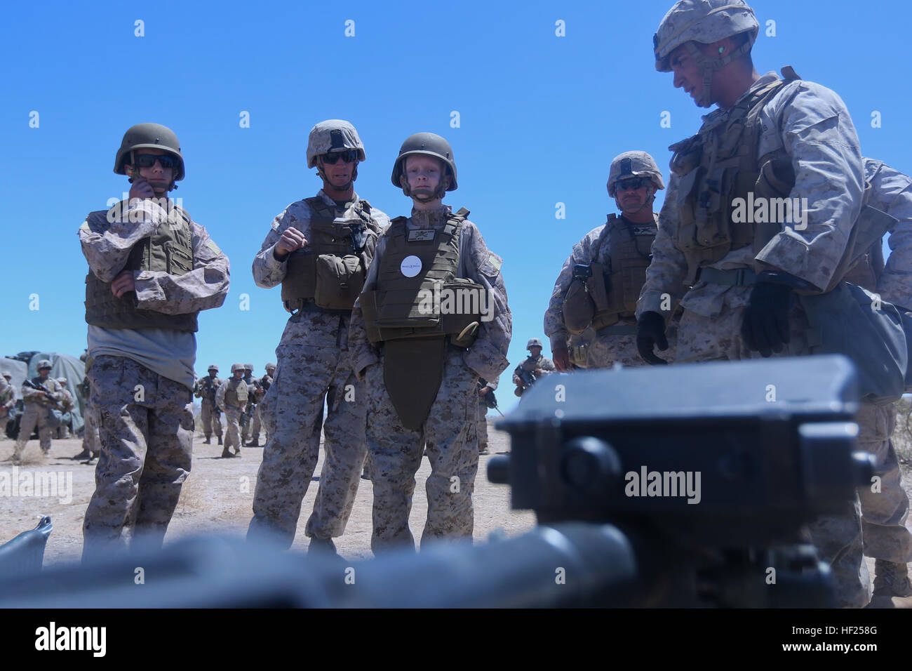 Ryan Forbes, third from left, a 13 year-old native of San Diego, talks with Marines about various weapon systems - Stock Image
