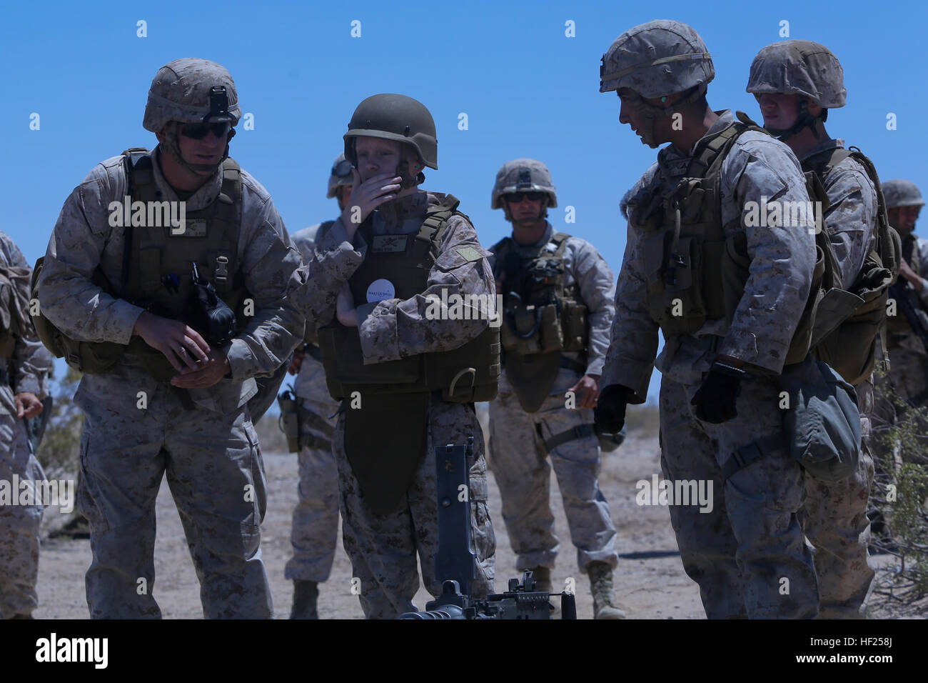 Ryan Forbes, second from left, a 13 year-old native of San Diego, talks with Marines about various weapon systems - Stock Image
