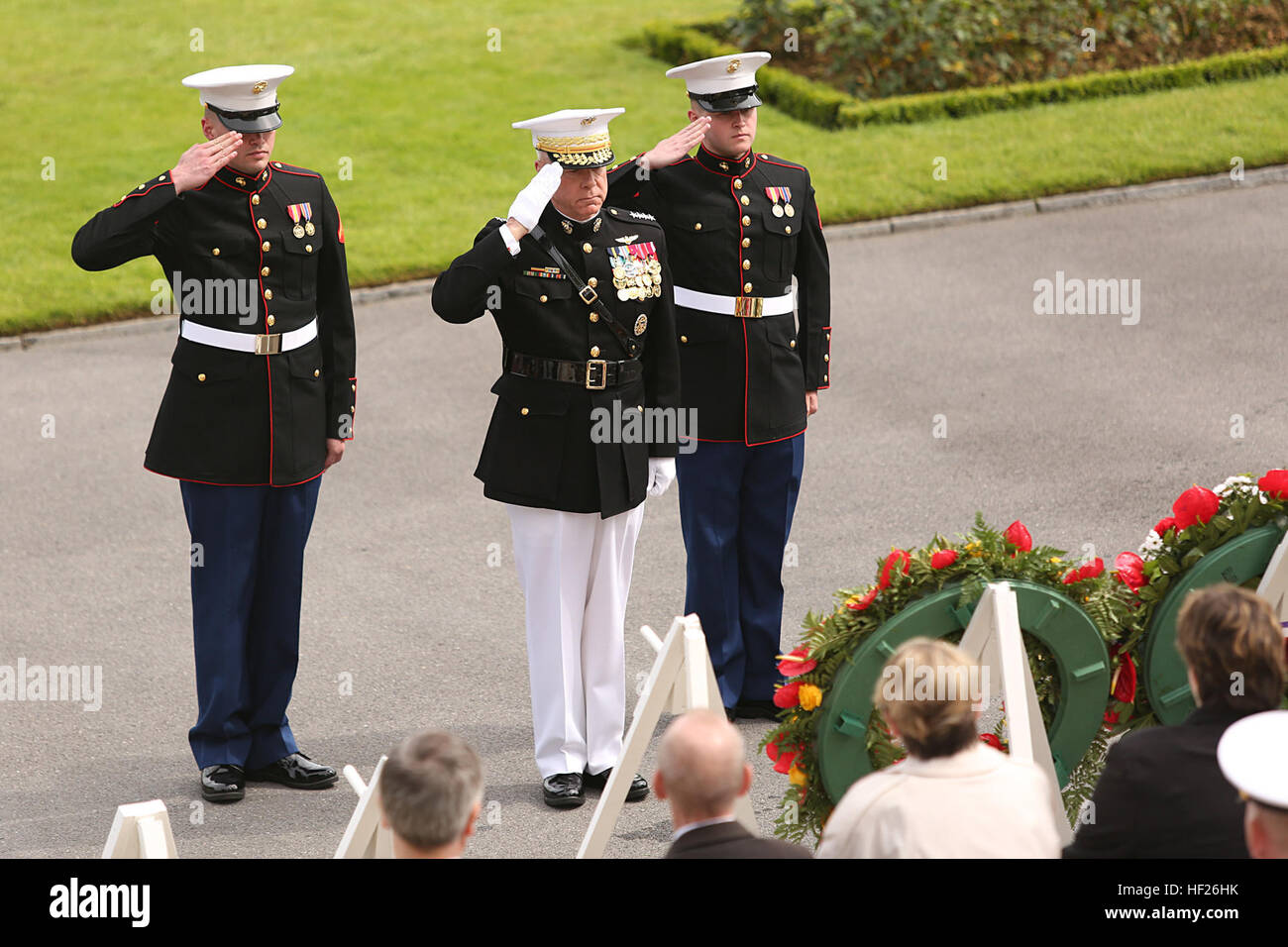 Lance Cpl. Robert Debevoise (left) and Lance Cpl. Tucker Brinkman assist the 35th Commandant of the Marine Corps, Stock Photo