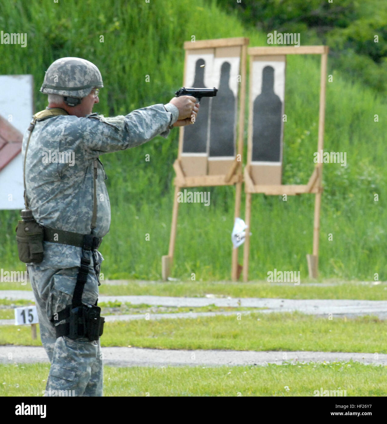 New York Guard Staff Sgt. Joseph Dee fires an M9 pistol during the 35th Annual 'TAG (The Adjutant General) Match - Stock Image