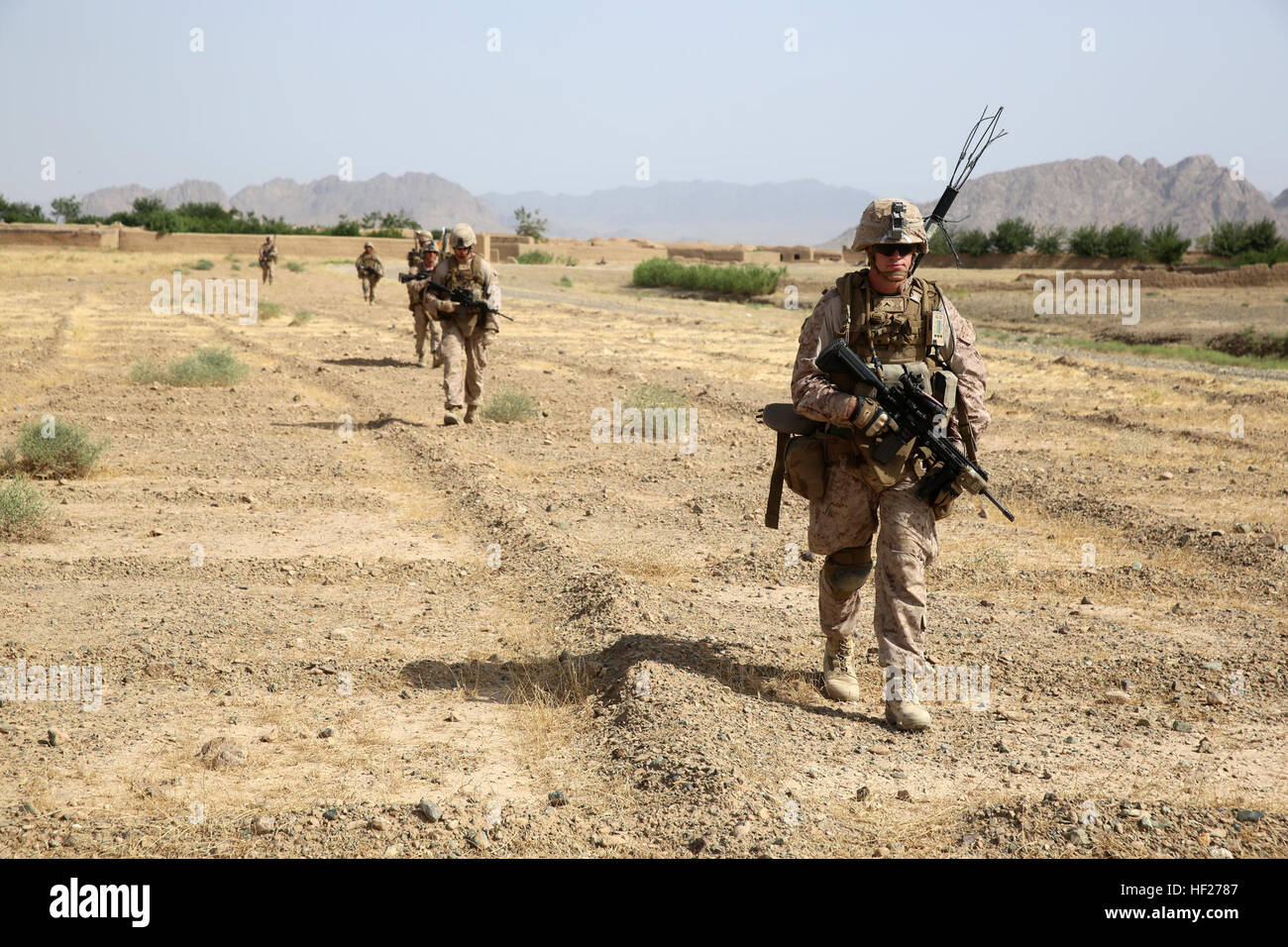 Marines with Bravo Company, 1st Battalion, 7th Marine Regiment, conduct a security patrol during a mission in Helmand - Stock Image