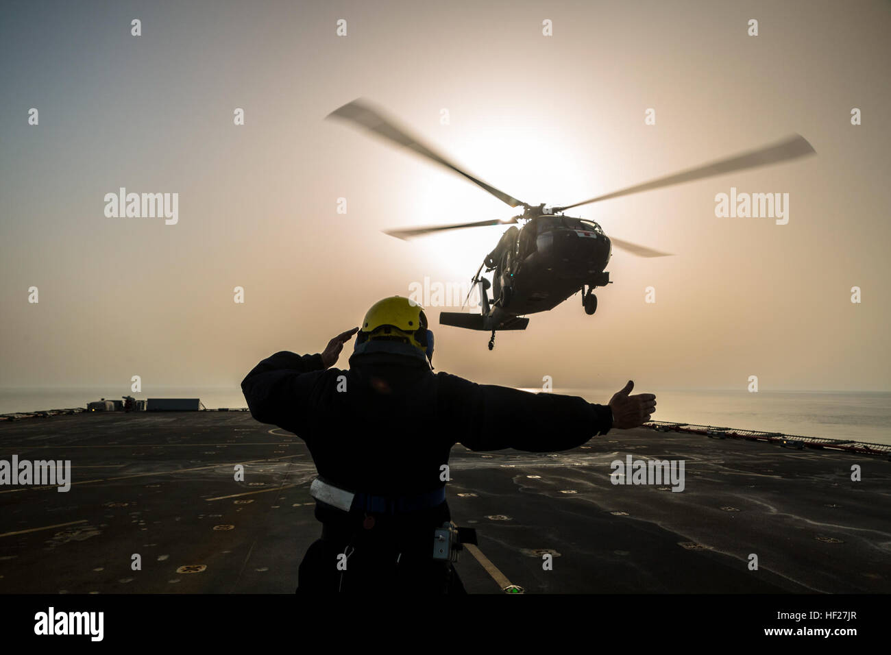 Petty Officer Ian Walker, a deck hand on the RFA Cardigan Bay, Royal Fleet Auxiliary, U.K. Royal Navy, gives the Stock Photo