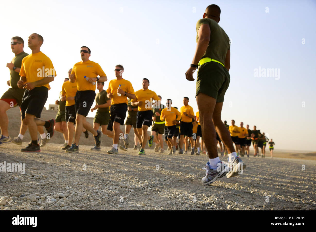 U.S. Navy sailors and U.S. Marines participate in a motivational 'moto' run aboard Camp Bastion, Helmand - Stock Image