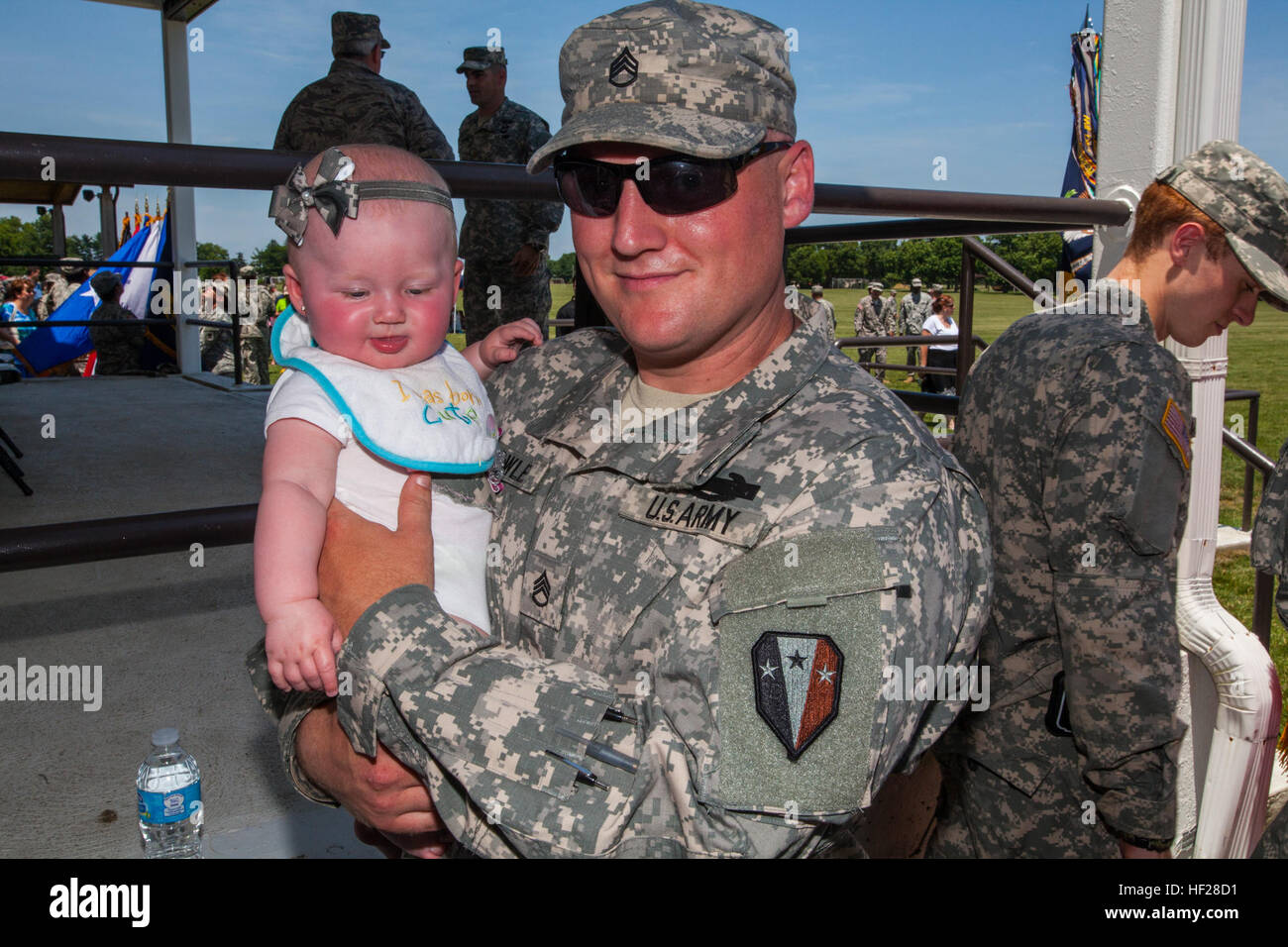 Staff Sgt. Mark Towle, B Company, 1-114th Infantry, New Jersey Army National Guard, spends time with his daughter - Stock Image