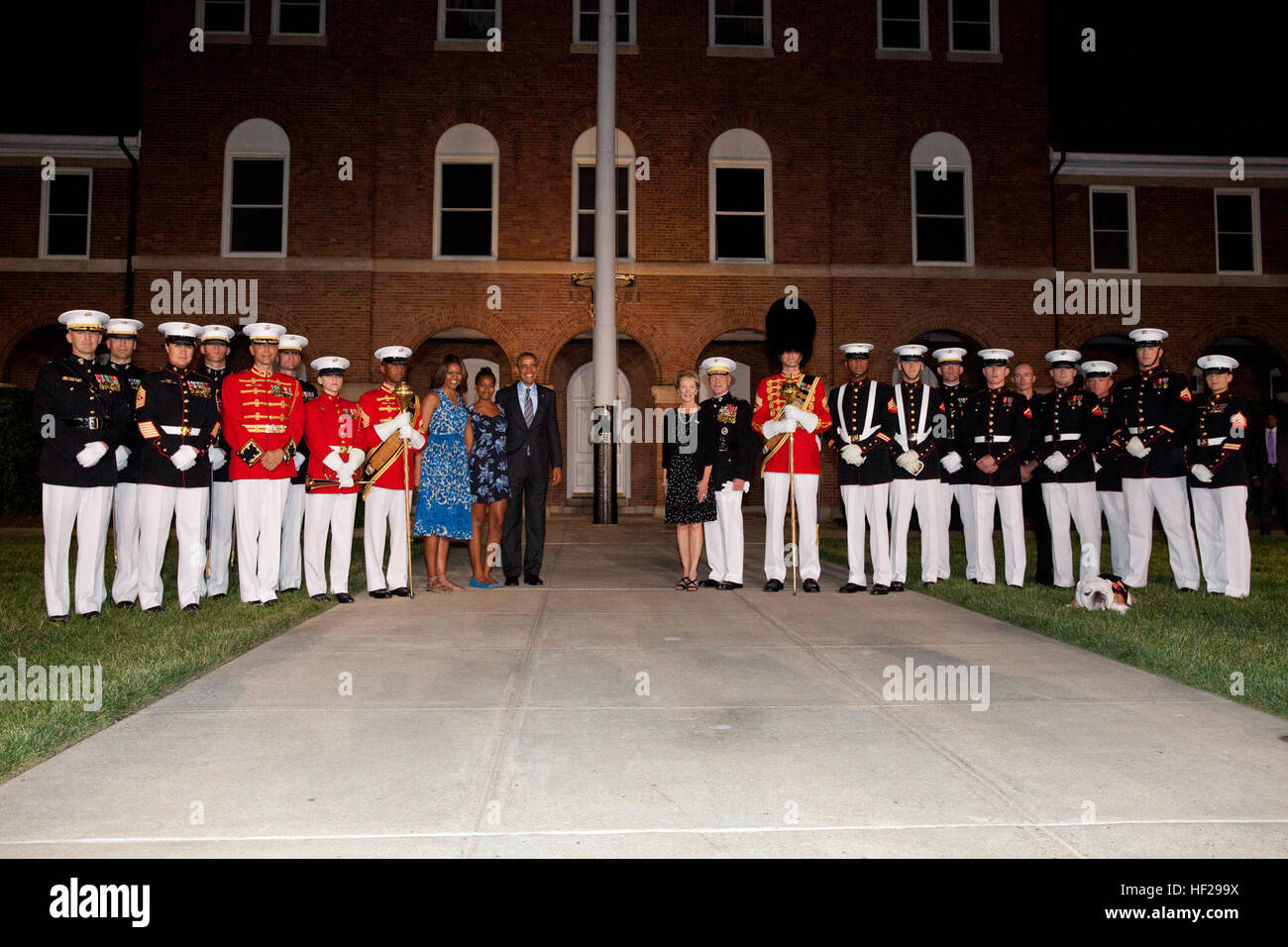 From center left, First Lady of the United States Michelle Obama; Sasha Obama; the Evening Parade guest of honor, Stock Photo