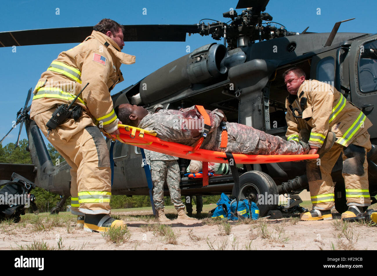 Fire fighters with McCrady Fire Rescue lift a casualty and carry them away from the South Carolina National Guard - Stock Image
