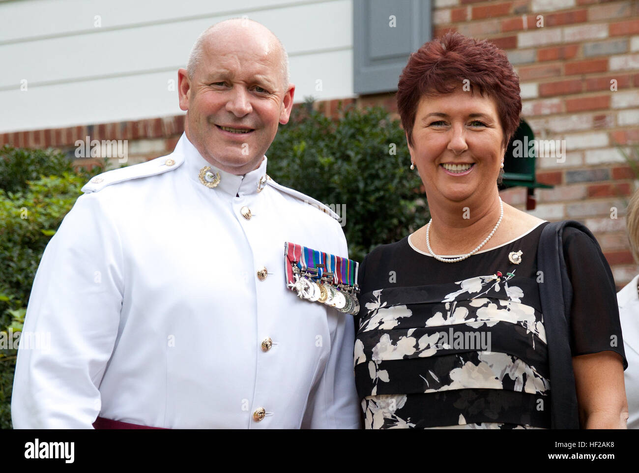 The Corps Regimental Sergeant Major of the British Royal Marines, Sgt. Maj. Allistar McGill, left, and his wife, Stock Photo
