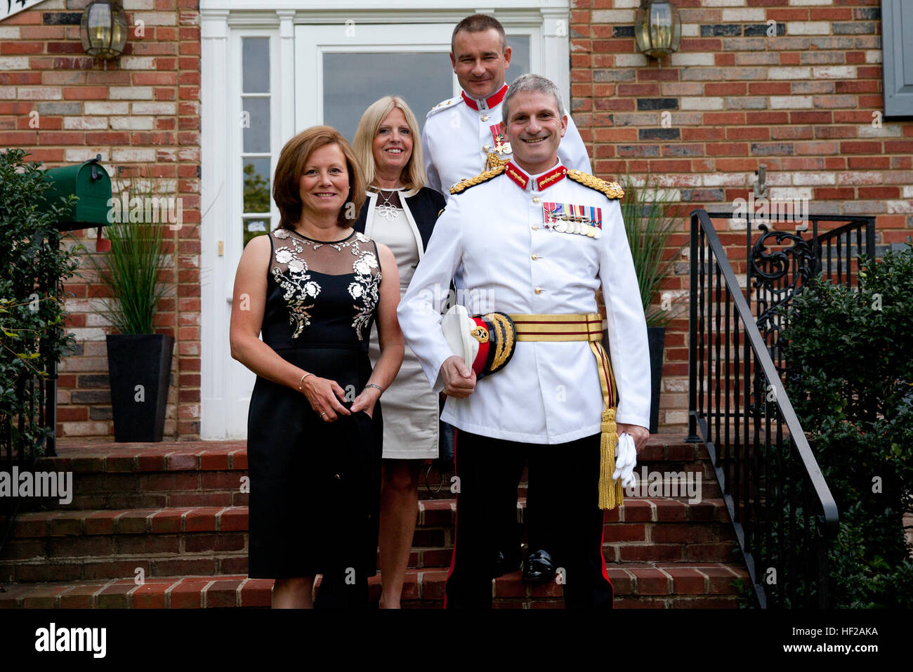 From left, Sue Smith; Helen Lister; British Royal Marine Attache Col. Al Lister; and Commandant General of the British Stock Photo