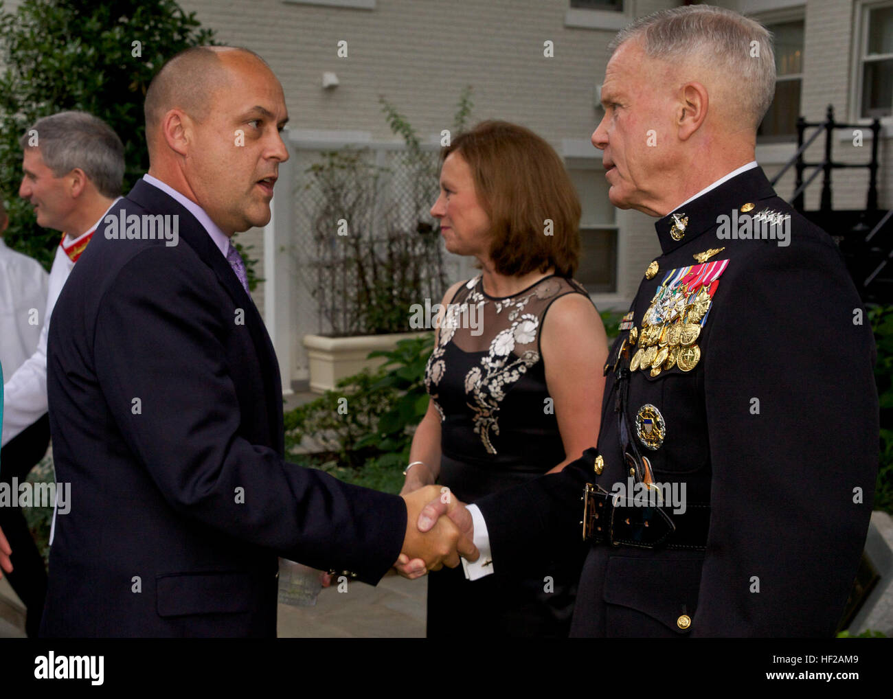 The Commandant of the U.S. Marine Corps, Gen. James F. Amos, right, greets with a guest during an Evening Parade Stock Photo