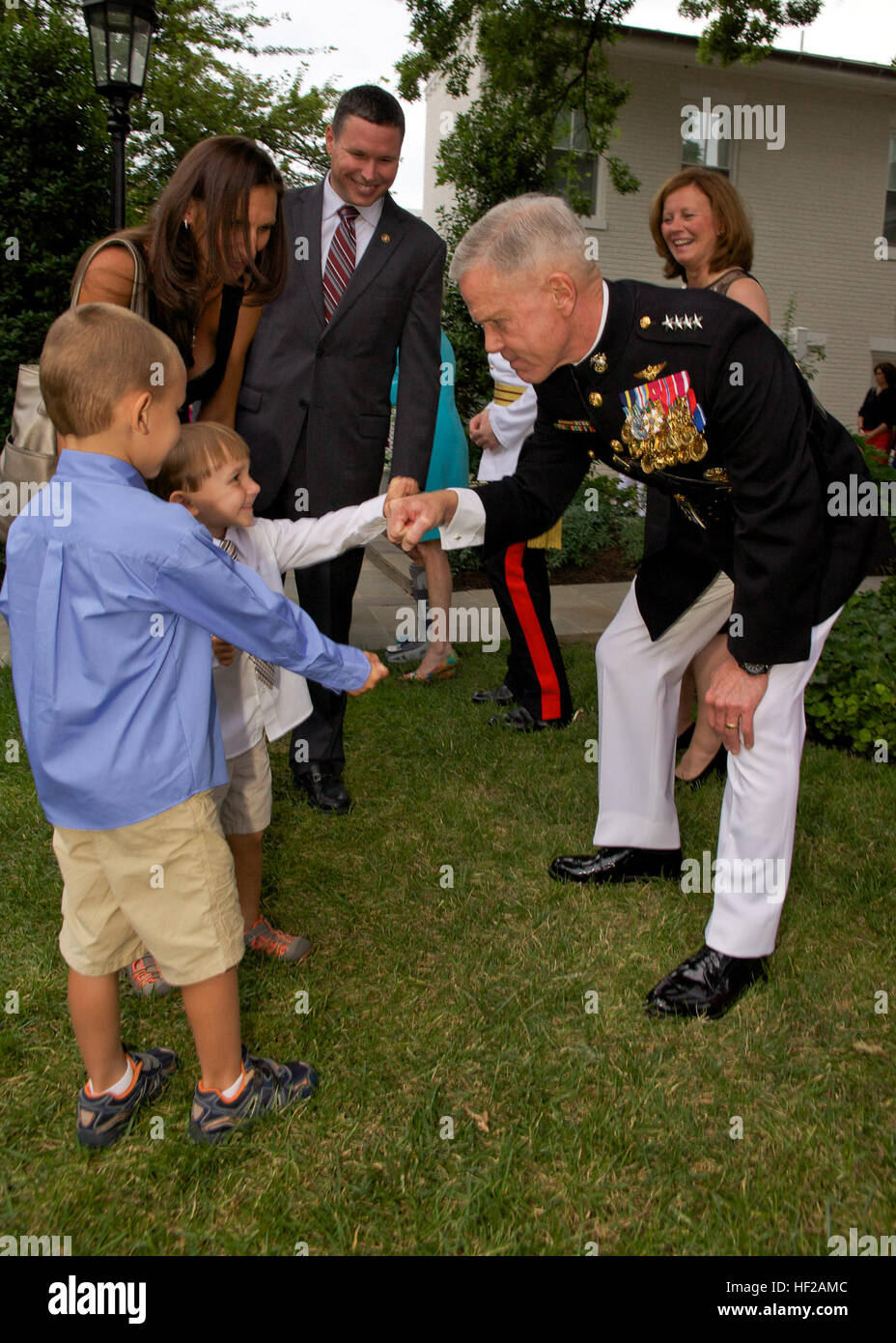 The Commandant of the U.S. Marine Corps, Gen. James F. Amos, right, greets young guests during an Evening Parade Stock Photo