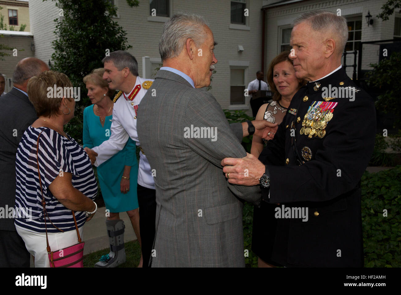 The Commandant of the U.S. Marine Corps, Gen. James F. Amos, right, greets a guest during an Evening Parade reception Stock Photo