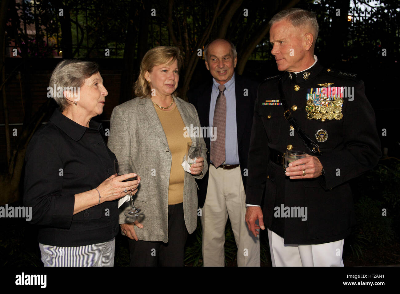 The Commandant of the U.S. Marine Corps, Gen. James F. Amos, right, speaks with guests during an Evening Parade Stock Photo
