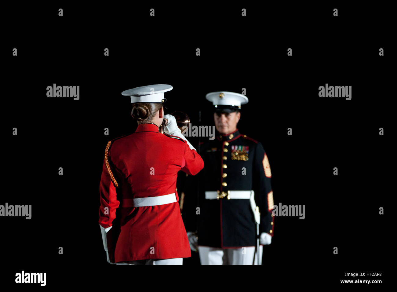 The Sergeant Major of Marine Barracks Washington, Sgt. Maj. Angela Maness, rear, stands at center walk with a ceremonial Stock Photo