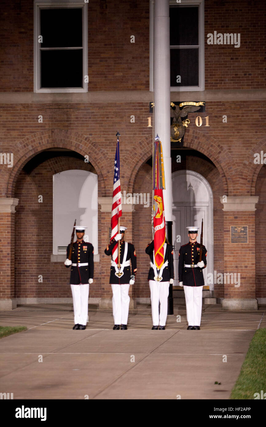 Members of a U.S. Marine Corps color guard present the colors during an Evening Parade at Marine Barracks Washington Stock Photo