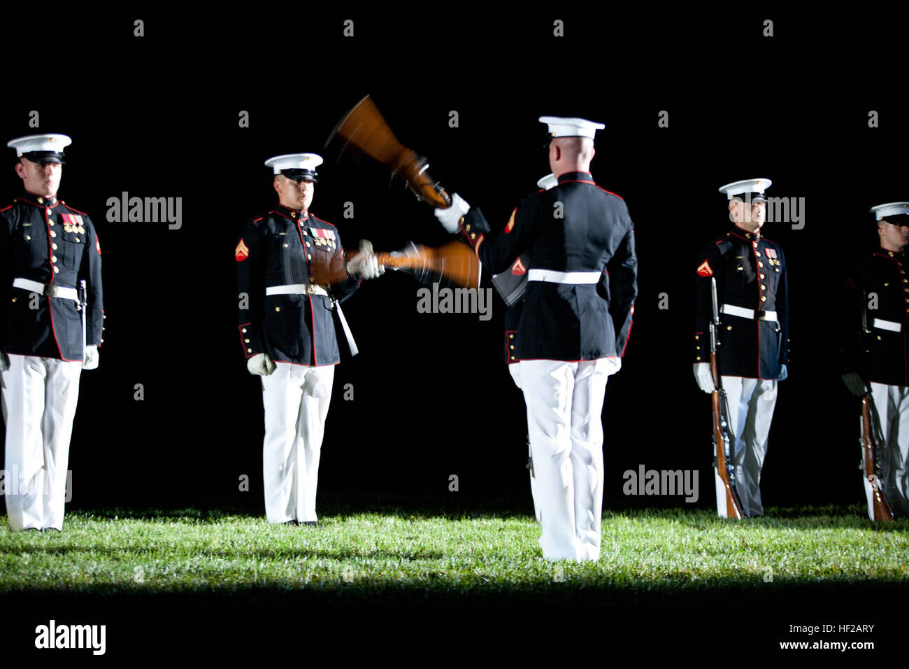 Members of the U.S. Marine Corps Silent Drill Platoon perform during an Evening Parade at Marine Barracks Washington Stock Photo
