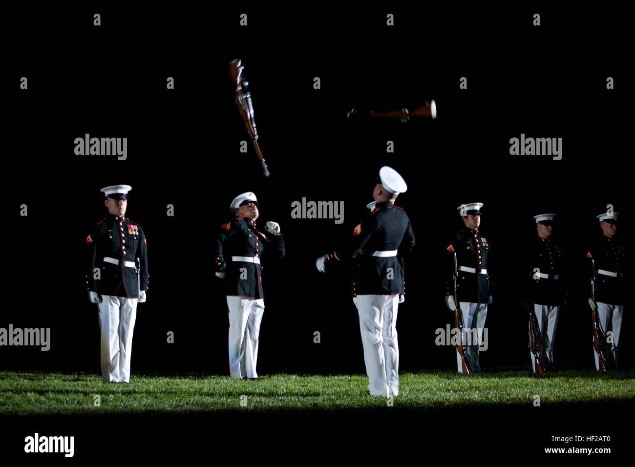 Members of the U.S. Marine Corps Silent Drill Platoon perform during an Evening Parade at Marine Barracks Washington Stock Photo