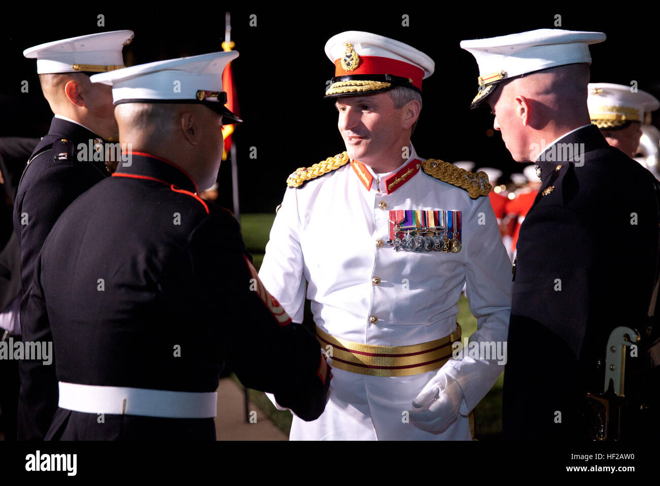 The Evening Parade guest of honor, Commandant General of the British Royal Marines Maj. Gen. Martin Smith, center, Stock Photo