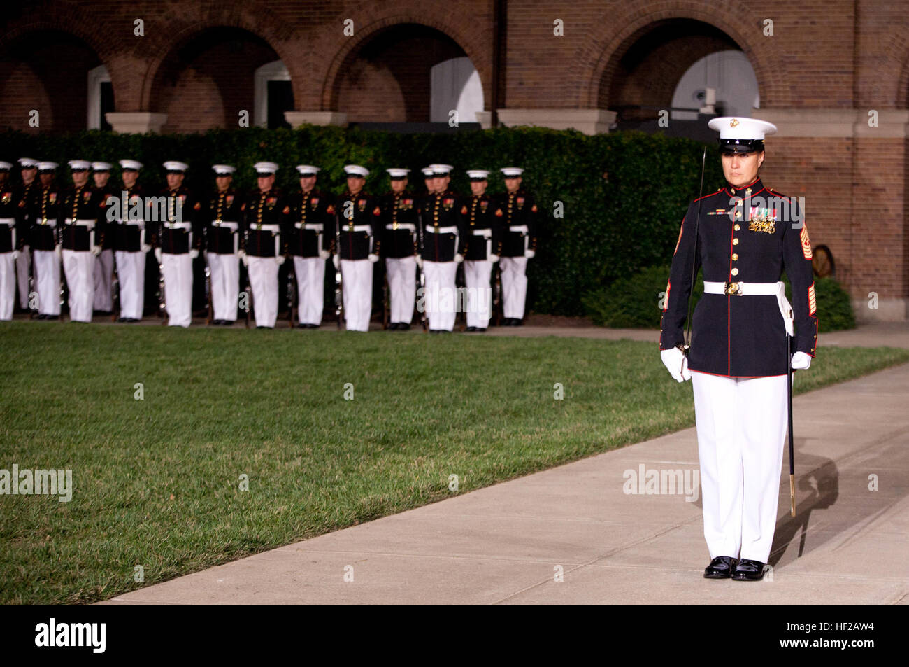 The Sergeant Major of Marine Barracks Washington, Sgt. Maj. Angela Maness, stands at center walk during an Evening Stock Photo