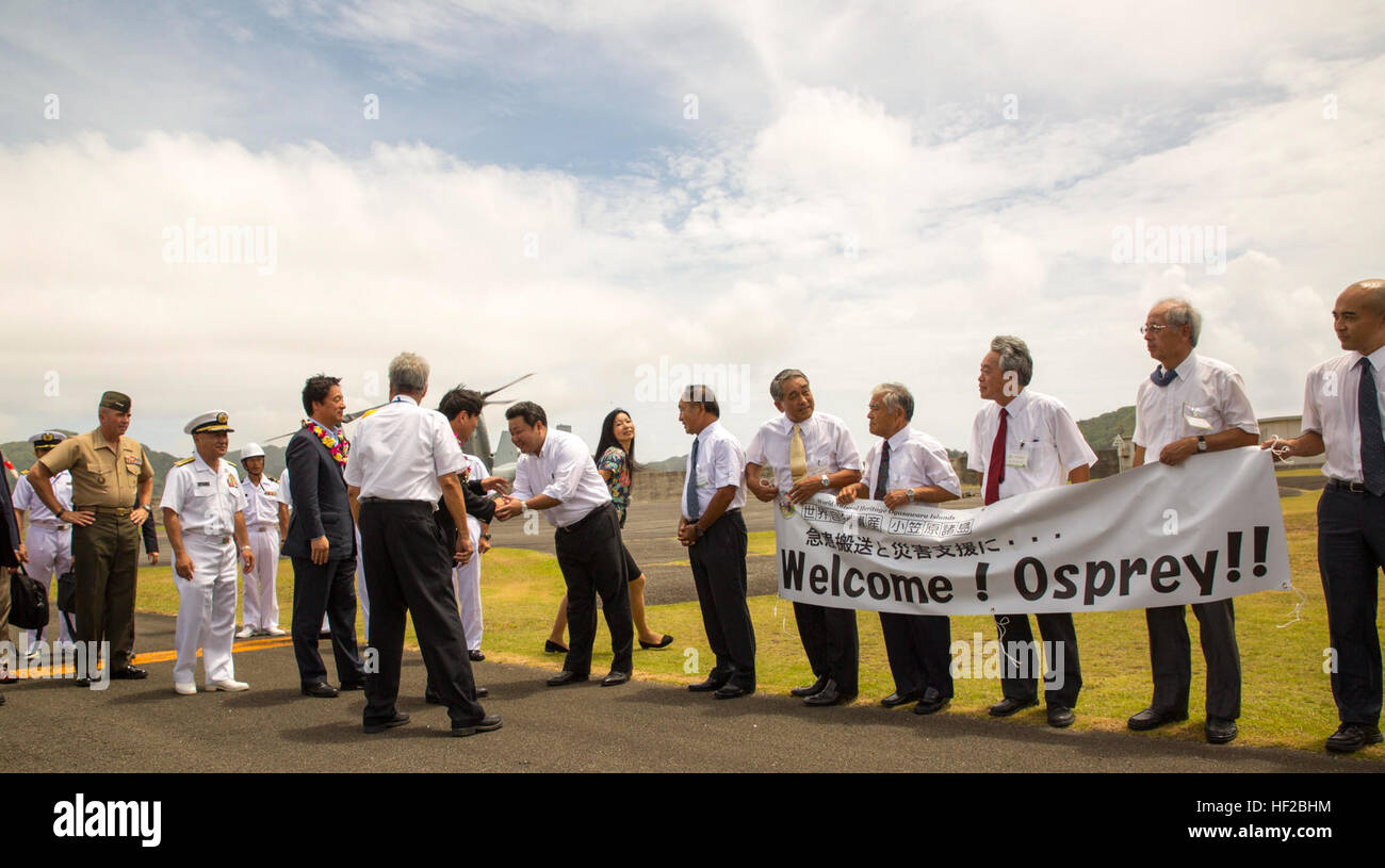 Ogasawara village assembly members greet senior military officials with the U.S. and Japan upon their arrival July - Stock Image