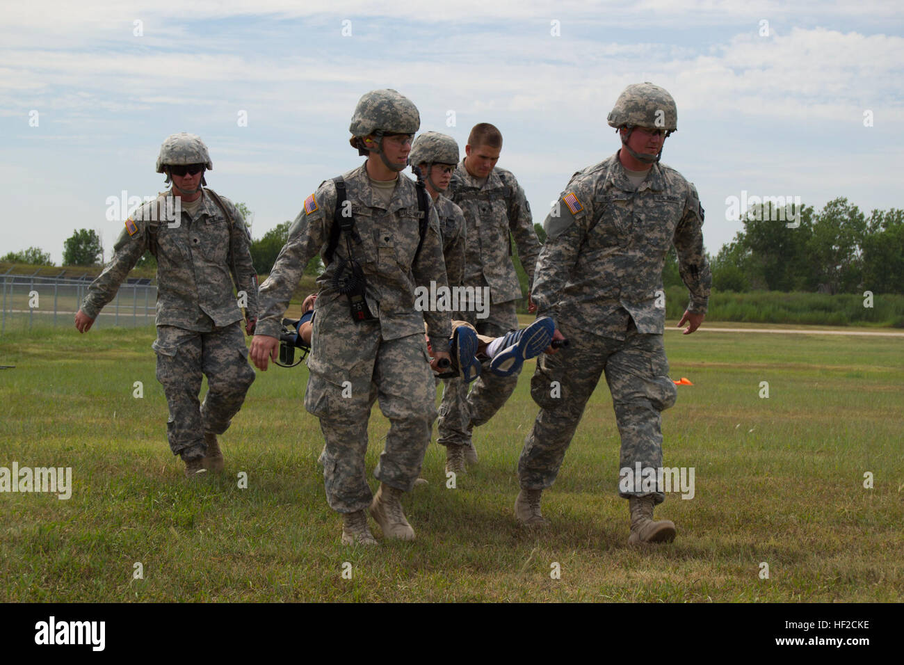 Members of the 1077th Ground Ambulance Company, Kansas Army National Guard, Olathe, Kan., and D Company, 1st Battalion, - Stock Image