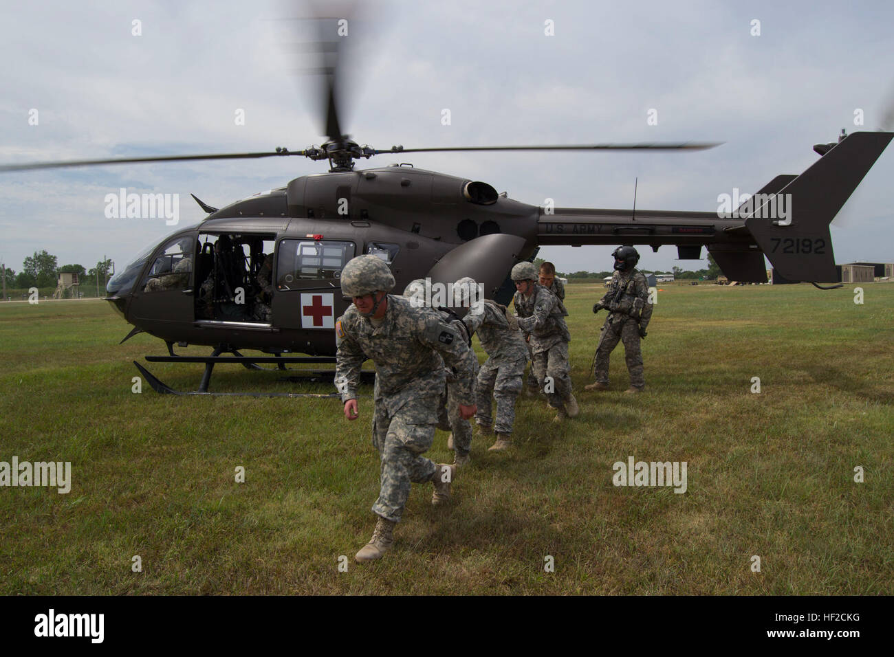 Members of 1077th Ground Ambulance Company, Kansas Army National Guard, Olathe, Kan., clear the area after loading - Stock Image