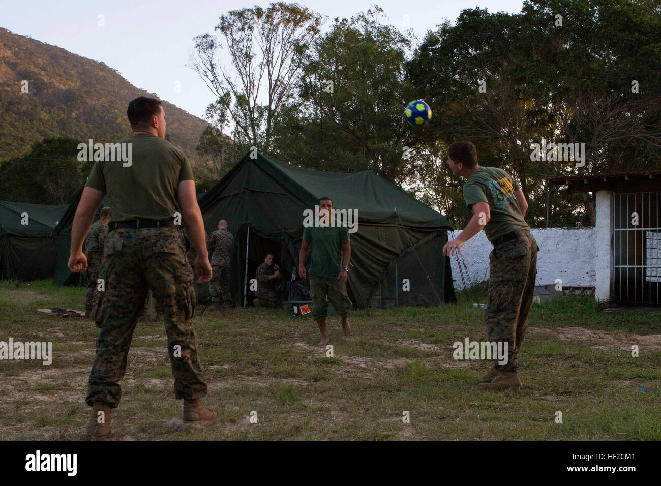 U.S. Marines Special Purpose Marine Air Ground Task Force South play soccer with Brazilian a Marine in the bivouac Stock Photo