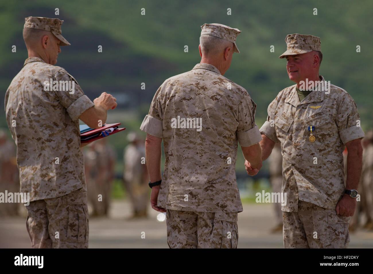 U.S. Marine Corps Gen. James F. Amos, commandant of the Marine Corps, presents awards to U.S. Marine Corps Lt. Gen. Stock Photo