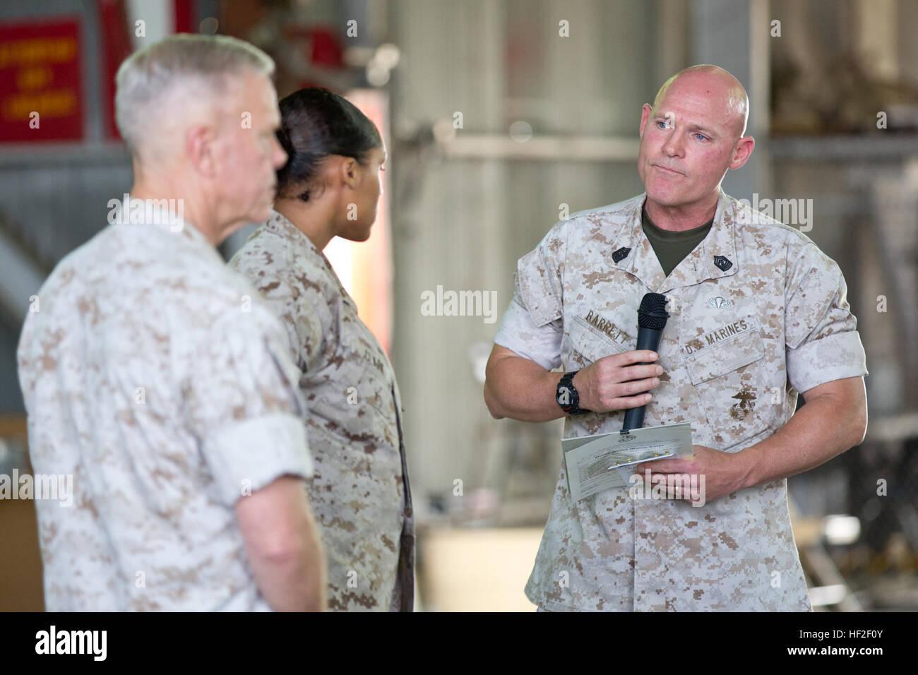 Sergeant Major of the Marine Corps, Sgt. Maj. Micheal P. Barrett, right, talks to Sgt. Malachijah M. Clark, center, Stock Photo