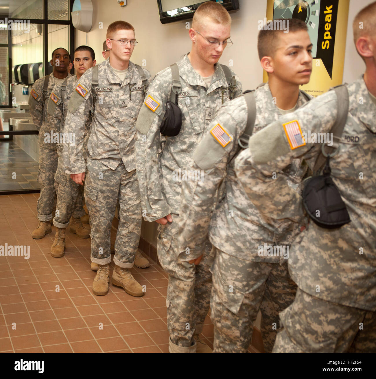 U.S. Army recruits stand and wait in line in the chow hall aboard Fort Jackson, S.C., on Sept. 4, 2014. Fort Jackson Stock Photo