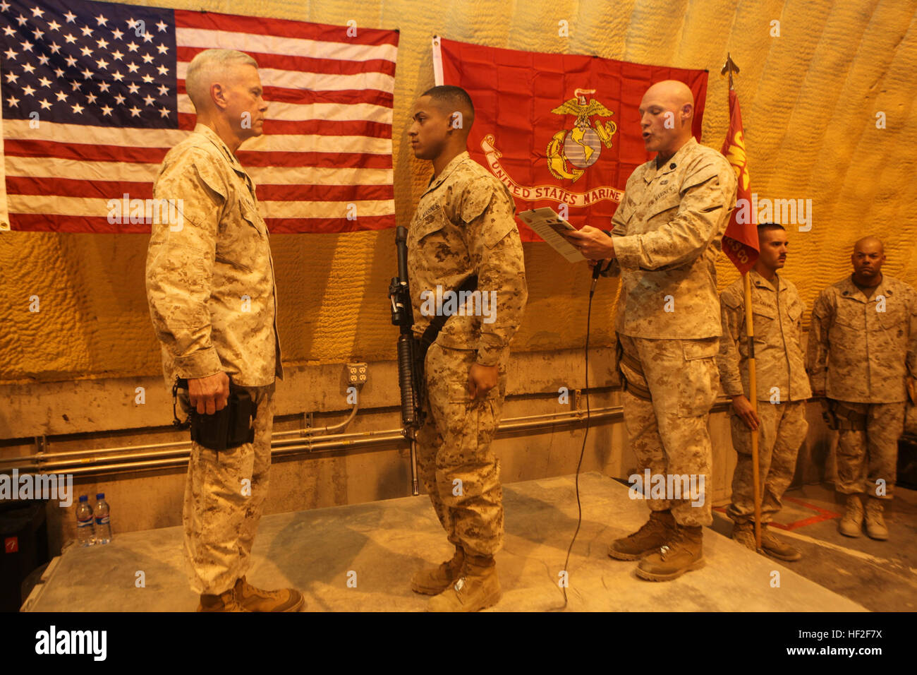 Sergeant Maj. Micheal Barrett, right, the 17th Sergeant Major of the Marine Corps, reads the meritorious promotion Stock Photo