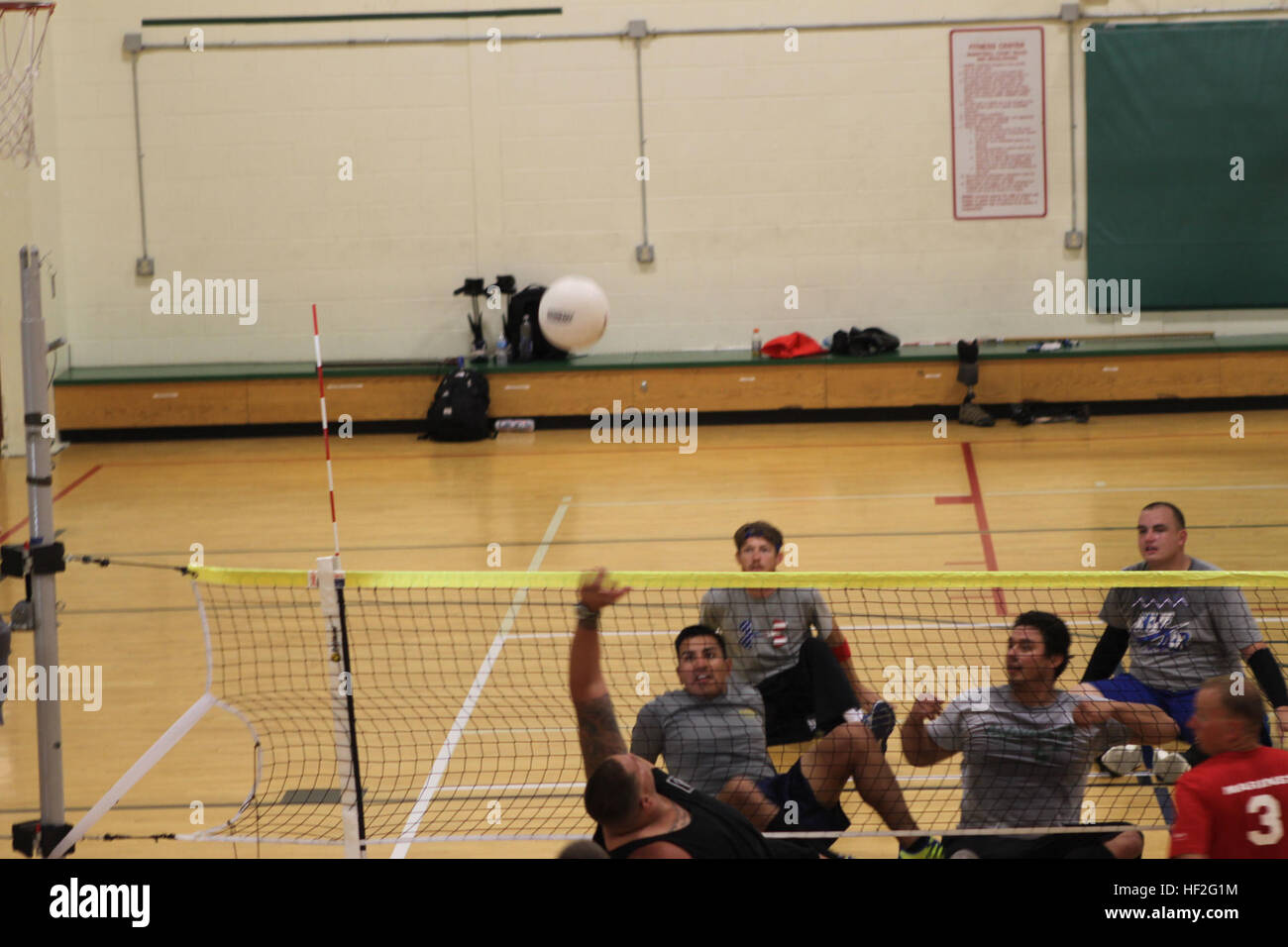 Sgt. Michael Wishnia, a native of Livingston, New Jersey, reaches to return a volley during sitting volleyball practice - Stock Image