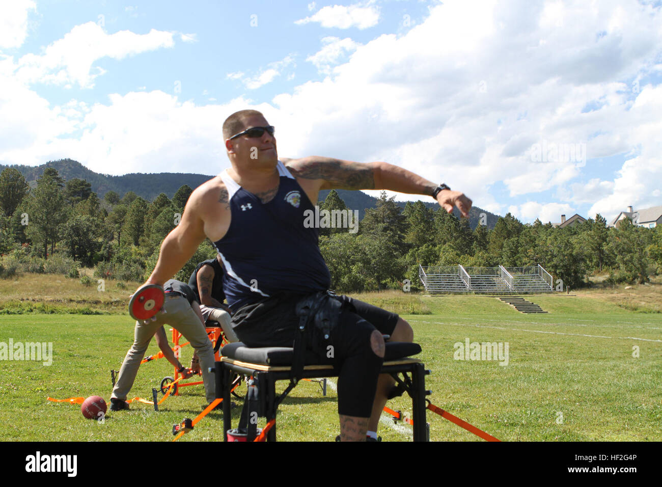 Sgt. Michael Wishnia, a native of Livingston, New Jersey, practices seated discus during the Marine team's field - Stock Image