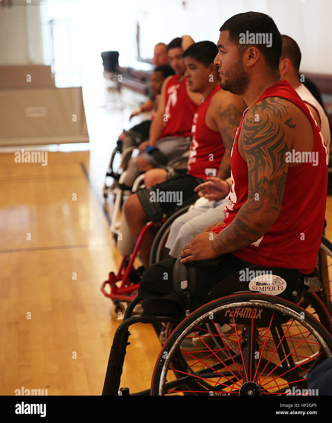 Cpl. Jorge Salazar from Delano, California, waits to begin practice with his teammates for the Marine team, Sept. - Stock Image